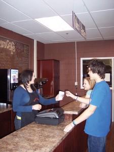 Rockford High School senior Brittany Schott serves student customers.