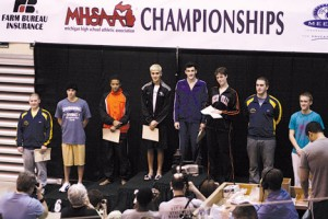 Ram diver Quinton Rodriguez receives a fourth-place medal. Photo by TRICIA AUGUSTINE
