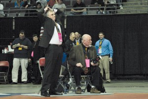 One last time, Coach Don Rinehart coaches his final match at the Palace of Auburn Hills on Saturday, March 14. Photo by JAMES COOPER