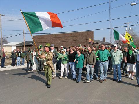Grand Marshal Rob Schaefer waving the Irish Tri-Color flag.