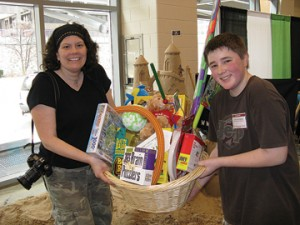 Sand Pirate, Janet Moore Schrader, awarding Justin Katerberg his first place grand prize in the 11 to 15 year-old age bracket of the Sand Castle Contest.