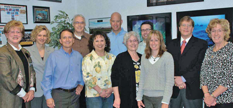 CHAMBER LEADERS—Board of Directors from L to R as follows: Char Bouwkamp (D & W Fresh Market), Bobbi Lindeman (Wolverine World Wide, Inc.), Vice President Dr. Carl Stites (Stites Eye Care), Jeff Lewis (Fluis, Inc.), Candy Lancioni (Aunt Candy's Toy Company), Andy Tidey (The Corner Bar), President Polly VonEschen (Baskets in the Belfry), Steve Hallead (Independent Bank), Jody Greco (City of Rockford – EX Officio), Secre
