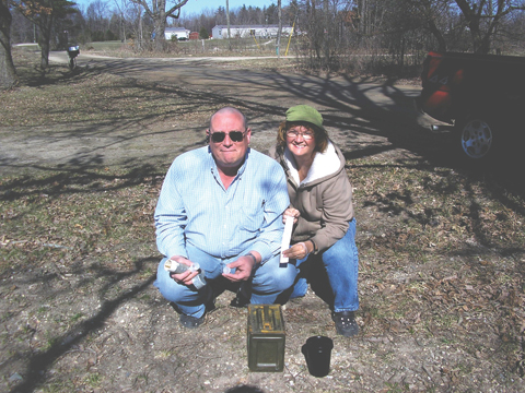 SIGNING THE LOG—Mark and Bevie Schmidt find a geocache on Roger Al