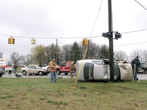 CRASH CAUSES INJURIES—A rollover accident rerouted traffic at Northland Drive and 14 Mile in the early afternoon Monday.
