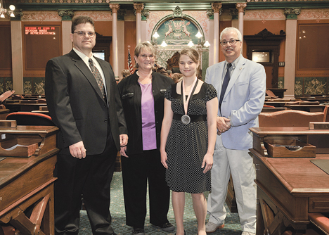 SPIRIT AWARD—State Rep. Tom Pearce, right, welcomed to the Michigan Capitol today Courtney Fedeson and her parents Brian
