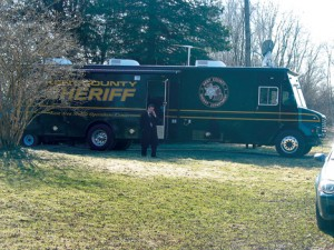 The Kent County forensic van is shown at the scene of the shooting Thursday, March 26.