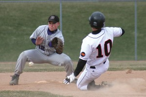 Zach Vanderweide slides into base during the game against Greenville.	Photo by KANDI JEZAK