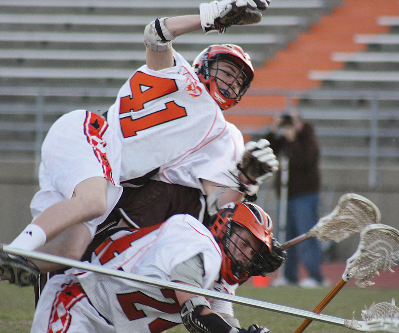 Brandon Emmons (#41) goes airborne after an illegal push from behind by a Holt player, as he and Nicky Howard (#24)