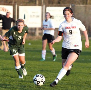 Senior outside mid Rachel Doud outmaneuvers her Rockets opponent.