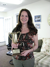 ESTEEMED AWARD—Dicksie Tremlin proudly shows her Arthur Andrews Cup award.