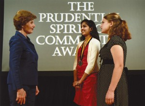 OUTSTANDING VOLUNTEER—Former First Lady Laura Bush congratulates Courtney Fedeson (far right), of Belmont.