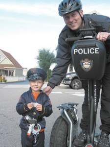 BAD ATTITUDE ISN'T AN OPTION—Rockford officer Ian Graham was diagnosed with lymphoma 12 weeks ago. He is pictured here during Rockford Harvest Festival last year with a trick-or-treat 'officer.'