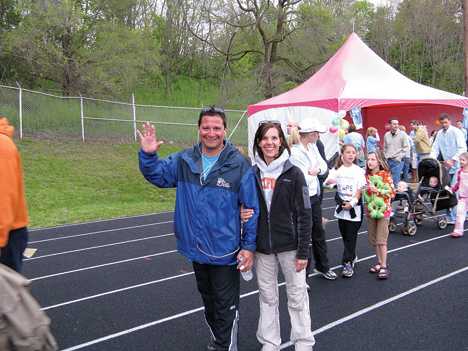 A LONG WALK—City Manager Michael Young, who pledged to walk the entire 24 hours of the Rockford Relay For LIfe, about to enter the 5th hour.  With 19 hours to go Young was being given encouragement