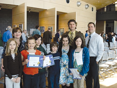 Roguewood students receive their award. Right is Emily Schnepp receiving Valley Views Green School award.