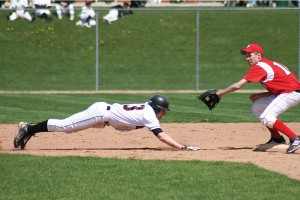 John Veitengruber dives to second base in the double-header against Holland on May 2.	Photo by KANDI JEZAK