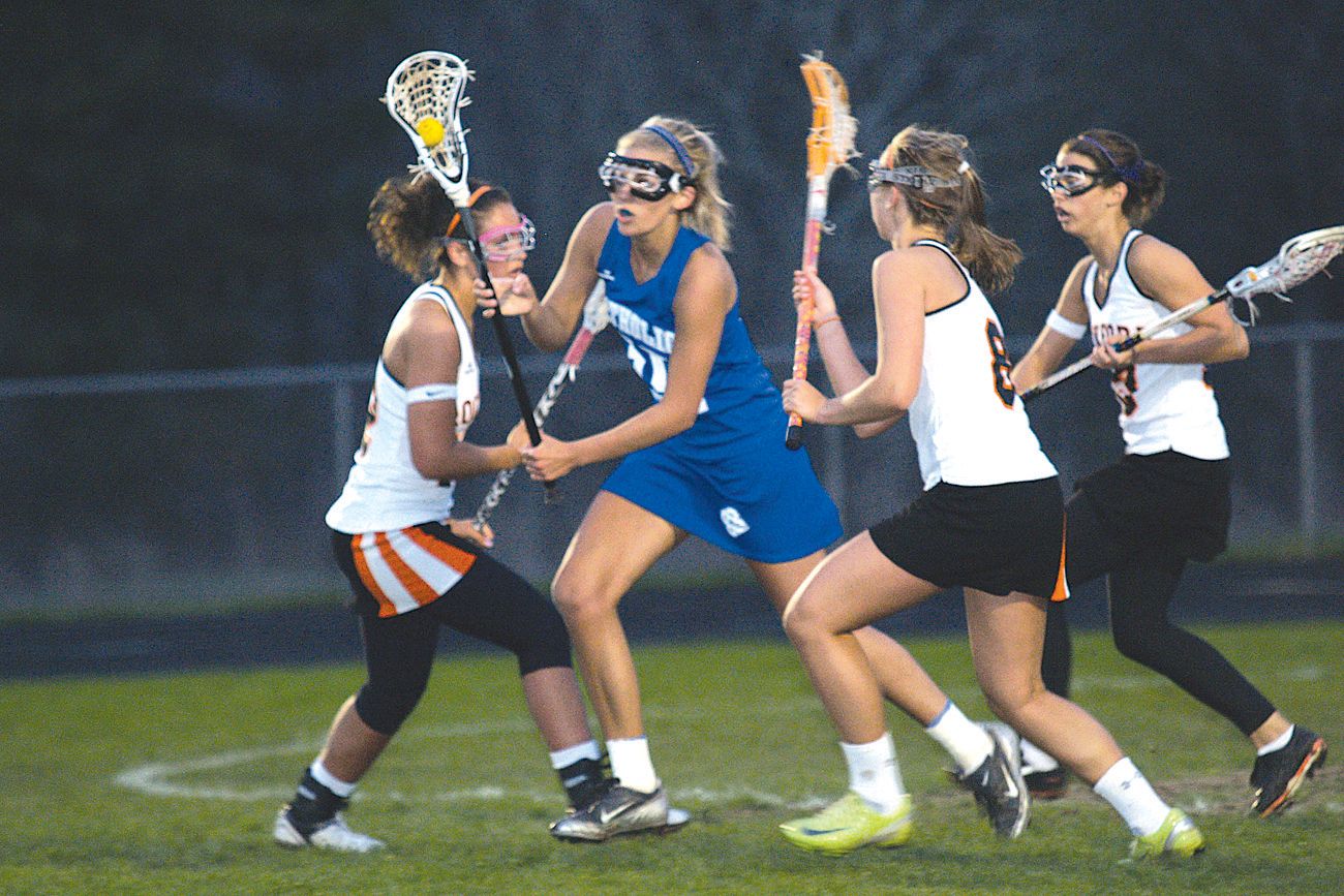Roxy Rosema (#12), Michon Moline (#13) and Taylor Hiner (#8) close in on Lauren McCarty from Catholic Central.