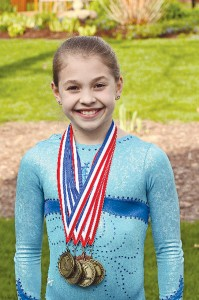 Olivia Dopkiss is named level six all-around state champ.