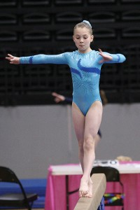 :  Olivia Dopkiss takes first place on the beam, scoring 9.425, at the USAG state meet May 2-3, 2009.