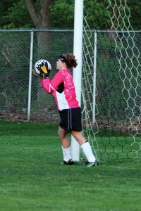 Junior keeper Hannah Rocheleau protects the goal during the conference tournament game against Grandville.Photo by BRET DOUD