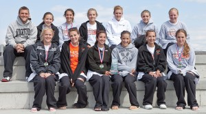 The Rockford girls varsity tennis team celebrates their first-place victory at the Ludington Invitational on Saturday, May 2.