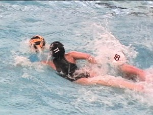 Mary Keeley out-swims a Grandville player.	Photo by PATRICK KEELEY