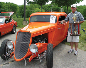 UNUSUAL RIDE—The big winner for the day was Jim Grzeszak. He and his wife Joy own this 1933 Ford. The vehicle features a fiberglass body built over the authentic Ford motor by a bodyshop in Danville, Kentucky.