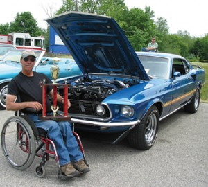 MACH WINNER—Ken Wright of Belding took second place at the second annual CABA Classic Car Show on Saturday, June 6. His auto is a  1969 Ford Mustang Mach I in Acapulco blue.