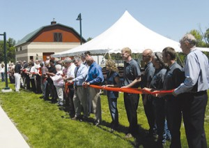 GROUP EFFORT—Those who were involved in the creation of the North Kent Sewer Authority plant were asked to take part in a ribbon cutting Friday, June 5.