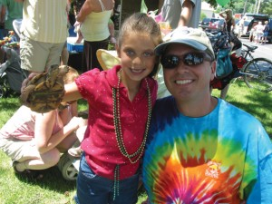 OLD-TIME FUN—Frog and turtle races downtown Rockford are a staple of the Start of Summer Celebration. Here a youngster holds up her racing box turtle before the event.
