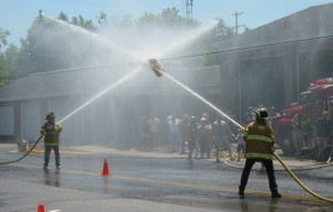 DO YOU WANT TO BE A FIREFIGHTER?—Again this year join Rockford firefighters in waterball competitions outside the firebarn following the parade on Saturday. You must sign up by calling Rockford Fire Chief Mike Reus at (616) 866-1553.