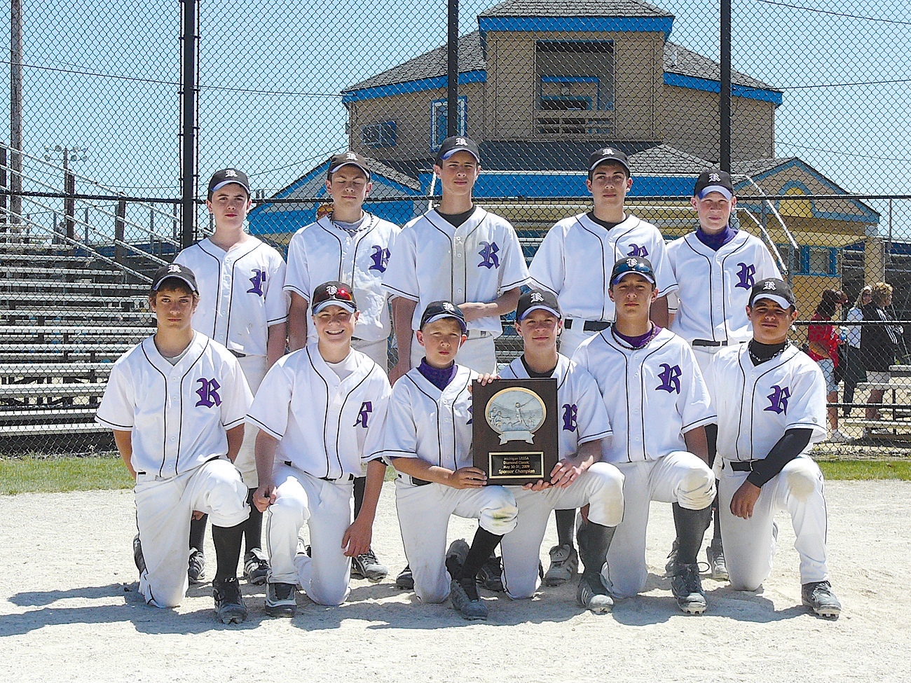 The undefeated Rockford Raptors 13U baseball team of (front, l–r) Matt DiLeo, David Sokol, Bobby Wilson, Jon Stewart, Kory Young, Brent Showers; (back) Andy Woodruff, Reid Kelley, Josh Neideck, Ryan Jerrils and Andrew Searl bring home the Diamond Classic tournament