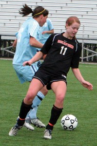 Senior defender Lindsey Hutchings (#11) makes a move for the ball.	Photo by BRET DOUD