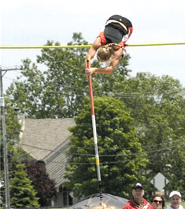 "Sarah Birkmeier defends her state championship title by vaulting 13'0"" at the state finals May 30."