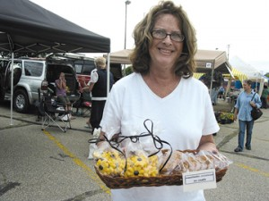 Nancy Ann's Cookies and Cupcakes, of Rockford, sold out of all but these few items at last week's Plainfield Farm Market. Her specialty is red velvet cake. Her husband (not pictured) said he does all the work.