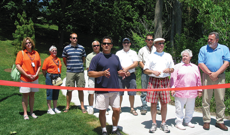 City officials and representatives of the Rogue River Trail Phase II were present to celebrate the ribbon cutting of the nature trail in June, 2008. It earned national honors for alliances.