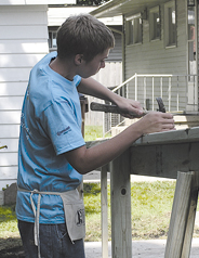 ON THE JOB—Nate Jansen of Cutlerville lends a hand in building the ramp.