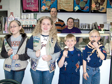 Enjoying an ice cream treat are (front, l–r) Girl Scouts Laurel Kurk