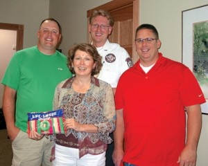 THANKFUL—Angela Dykes took the time to share her story with the first responders who kept her alive following a head-on crash January 2008. Pictured with Dykes are Rockford Ambulance paramedics Jeff Ripley