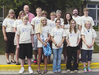 HARD WORKERS—Members of St. Peter's Lutheran Church (front, l–r) Andrew Elenbaas, Andee Petersen, Elyse S