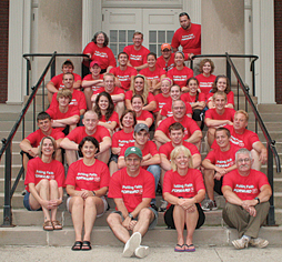 HARD  WORKERS—The members of the Rockford United Methodist Church Appalachia Service Project Team sit on the steps of the Union Church in Berea, Kentucky, where they stop each year for Sensitivity Training and church on Sunday.