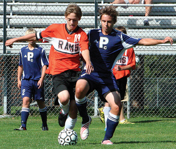 Connor Doud (#10) battles his Mustang opponent for the ball.