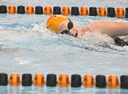 Junior Lexy Castor swims in the 100 free against Zeeland.	Photo by SHANNON OUELLETTE