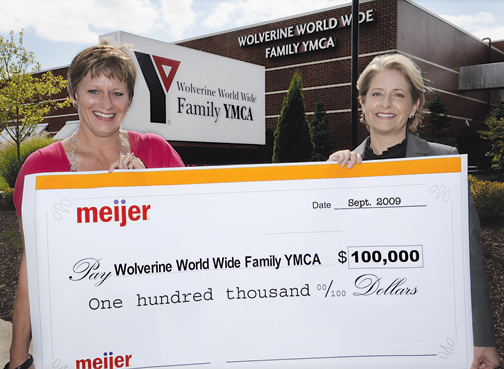 BIG BUCKS—Bev Thiel, executive director of the WWW YMCA and Stacie Behler, vice president of corporate communication and public affairs at Meijer.