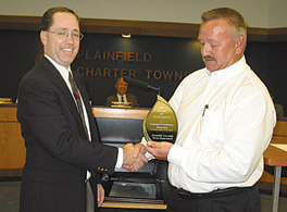 Tom Smith of the American Water Works Association presents Don Petrovich with the American Water Works Association award  for the township's successful wellhead protection program.