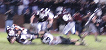 Joe Stefanski hammers the Grandville quarterback.	Photo by TONY ANDERSON