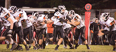 Taylor Masiewicz (#11) is ready to hand the ball off to Joey Johnson (#3) in hopes of big yardage.	Photo by TOM SCOTT