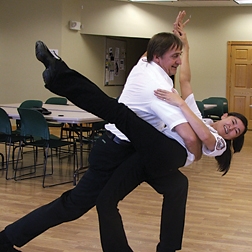 GIVE IT A WHIRL—Andy Andresen and Su Gray take a spin around the room at Rockford Ambulance. The paramedics and staff are inviting the public to come learn to waltz at the facility free of charge. Give them a call and give it a try. photo               by Ana Olvera