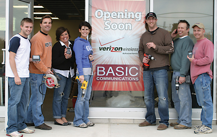 TEAMWORK OPENS DOORS—The team at Basic Communications all pitched in to prepare the store to open its doors at 2745 Ten Mile Road, Suite B. Pictured is Chuck Richardson, IT/administration, Bill Pellerito, general manager of retail sales, Stacey Sunday, assistant manager, Lindsay Maclead, sales associate, Josh Schmidt, sales associate, Clay Reynolds, store manager, and Rod Kirby, owner/vice president of Basic Communications.