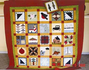 This quilt is comprised of Michigan-related squares and will be raffled off on Saturday, Nov. 21 at Bostwick Lake Congregational Church.