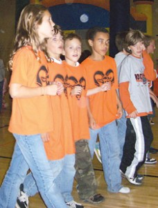 TAKING TURNS—Fourth-grade walkers (l–r) Zoe Anderson, Molly Robert, Michael Robert, Wendell Lanphear and Danny Froumis take their turn around the gym.
